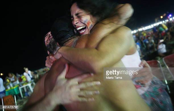 Costa Rica supporters celebrate after a shootout win over Greece while watching the FIFA Fan Fest live broadcast on Copacabana Beach on June June 29...