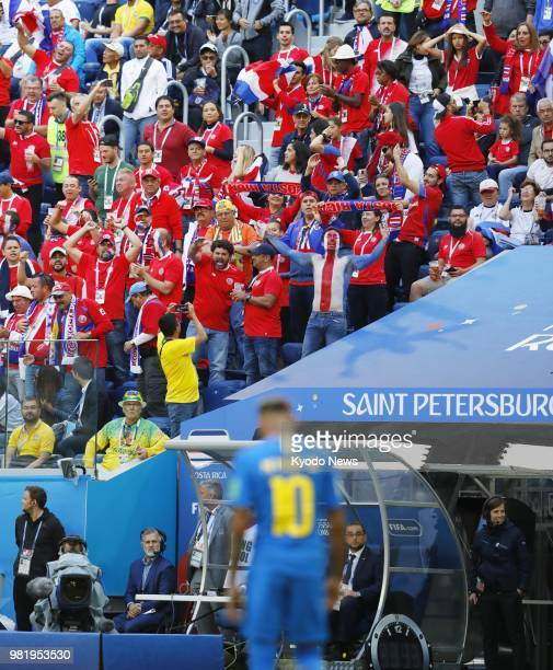 Costa Rica supporters celebrate after Video Assistant Referee intervention that overturned a penalty awarded to Brazil during the second half of a...