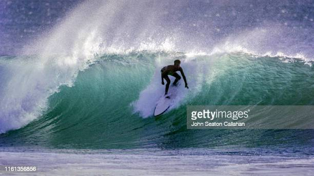 costa rica, surfing at playa grande - guanacaste stock pictures, royalty-free photos & images