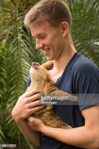 Costa Rica, Tourist with baby sloth.