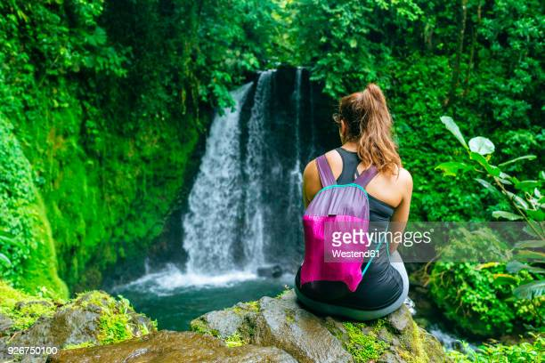 Costa Rica, Woman looking at a waterfall on the Cerro Chato route