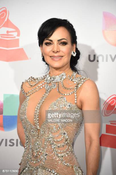 Costa Rican actress Maribel Guardia poses in the press room during the 18th Annual Latin Grammy Awards in Las Vegas Nevada on November 16 2017 / AFP...