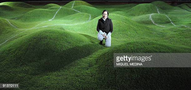 Costa Rican artist Priscilla Monge poses during the installation of her creation representing an uneven football field for the Paris annual...