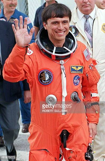 Costa Rican born Space Shuttle Columbia Astronaut Franklin ChangDiaz waves to wellwishers 22 February prior to boarding the Astro Van at Kennedy...
