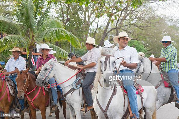 costa rican cowboys downtown playas del coco - guanacaste stock pictures, royalty-free photos & images