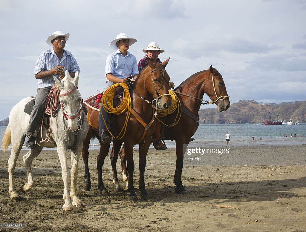 Costa Rican cowboys on the beach in Playas del Coco : Stock Photo