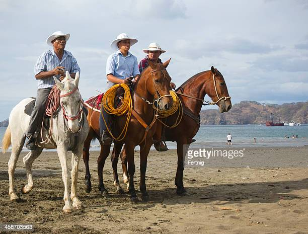 costa rican cowboys on the beach in playas del coco - guanacaste stock pictures, royalty-free photos & images