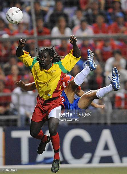 Costa Rican football player Celso Borges vies for the ball with Anthony Modeste from Grenada on June 21 at the Ricardo Saprissa stadium in San Jose...
