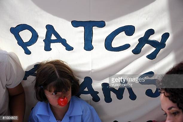 A Costa Rican girl with a red plastic nose waits for the arrival of US doctor Hunter Patch Adams at the Children Hospital in San Jose on May 6 2008...