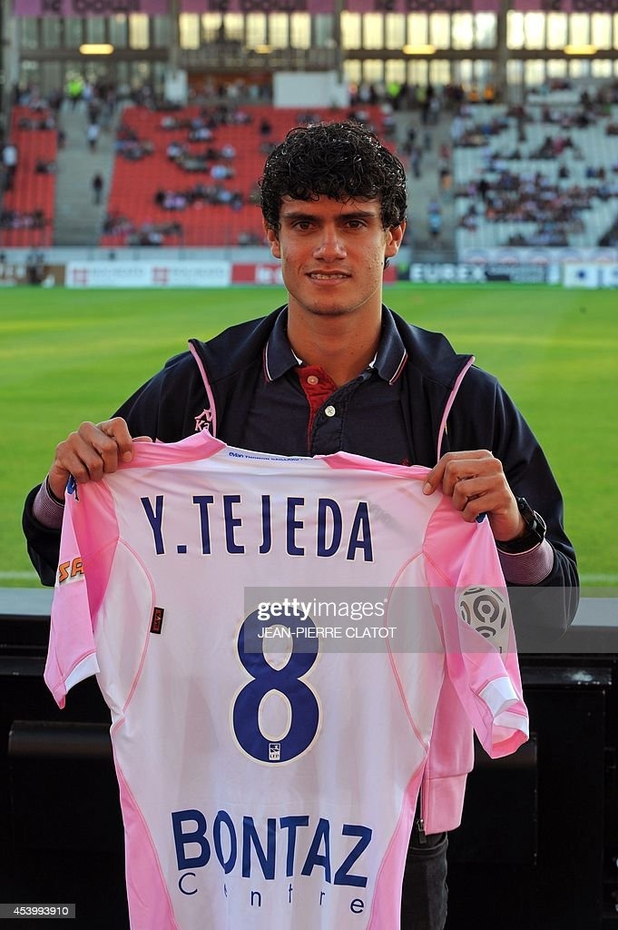 Costa Rican International midfielder Yeltsin Tejeda holds his new Evian Thonon Gaillard (ETGFC) jersey prior to the French L1 football match between Evian Thonon Gaillard (ETGFC) and Paris Saint-Germain (PSG) on August 22, 2014 at the Parc des Sport in Annecy, southeastern France.