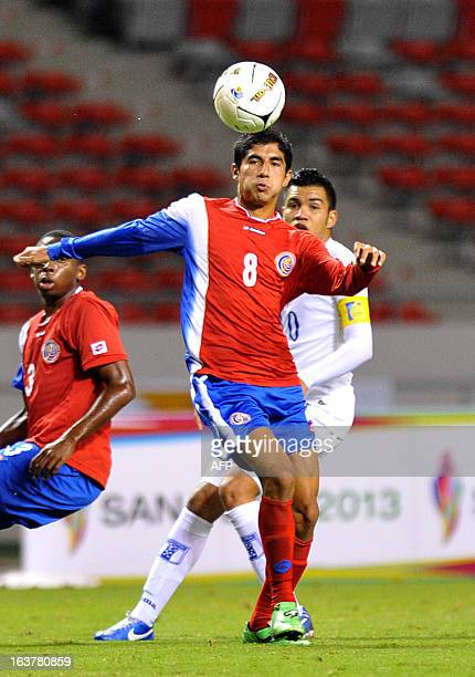 Costa Rican Luis Sequeira and Honduran Ramon Amador eye the ball during the men's football final of the 10th Central American Games in San Jose on...
