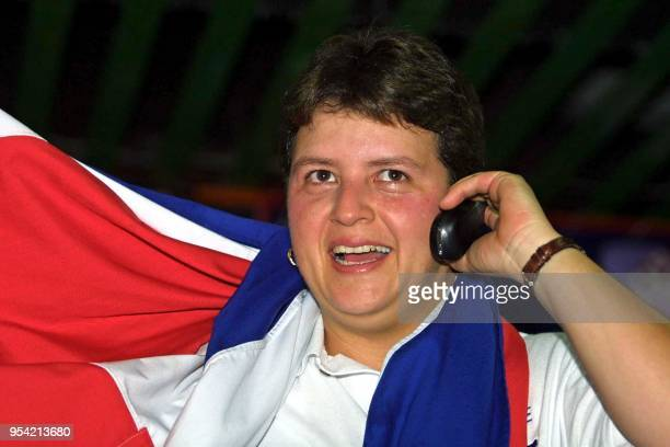 Costa Rican Marie Ramírez talks to her family via mobile after winning the gold medal during the bowling competition in San Salvador El Salvador 30...