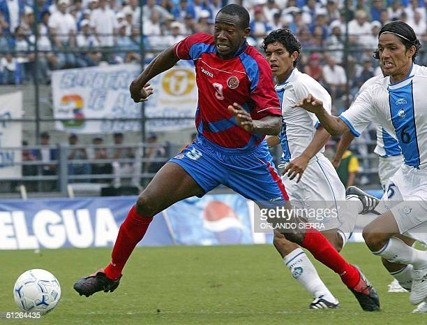 Costa Rican Paulo Wanchope eludes Guatemalan Gustavo Cabrera 05 September 2004 at Mateo Flores stadium in Guatemala City, during the FIFA World Cup...