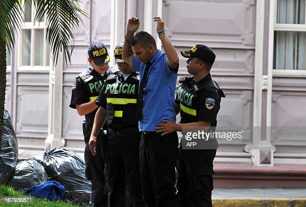 Costa Rican police personnel frisk a man on the eve of the visit of US President Barack Obama in San Jose on May 1 2013 Obama will visit Costa Rica...