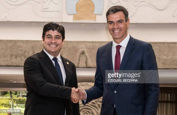 Costa Rican President Carlos Alvarado and Spanish Prime Minister Pedro Sanchez shake hands during a meeting at the Presidential House in San Jose on...
