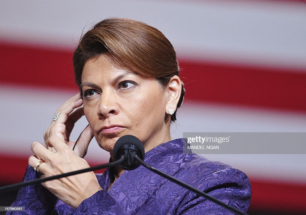 Costa Rican President Laura Chinchilla adjusts her earphone during a joint press conference with US President Barack Obama (out of frame) at the National Center for Culture, on May 3, 2013 in San Jose. AFP PHOTO/Mandel NGAN