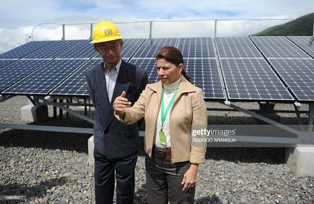 Costa Rican President Laura Chinchilla (R) and Japanese ambassador Yoshiharu Namiki talk during the inauguration of the Miravalles Solar Power Plant in Miravalles, 220 km north of San Jose, on November 22, 2012. Costa Rica inaugurated the largest plant of electricity from solar energy in Central America, which may generate 1.2 gigawats a year and was built with funds from the Japanese government. AFP PHOTO/Rodrigo ARANGUA