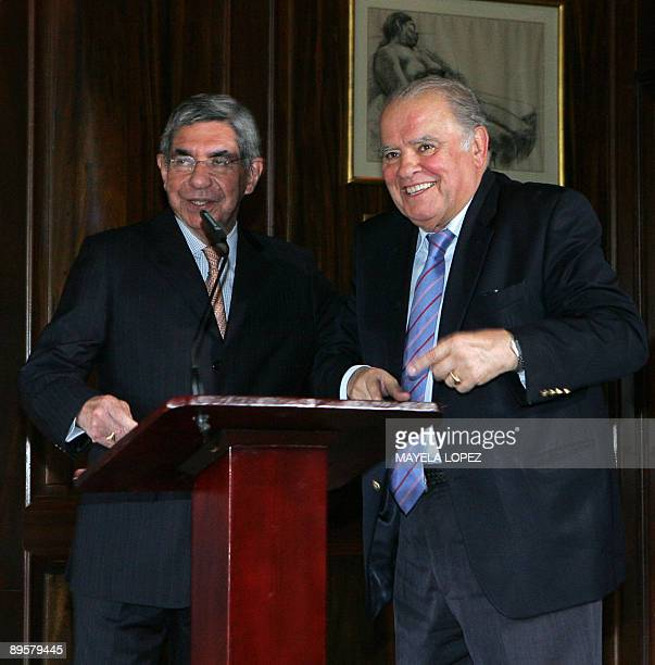 Costa Rican President Oscar Arias and Ibero American Secretary Enrique Iglesias joke during a press conference at Arias's residence in San Jose on...