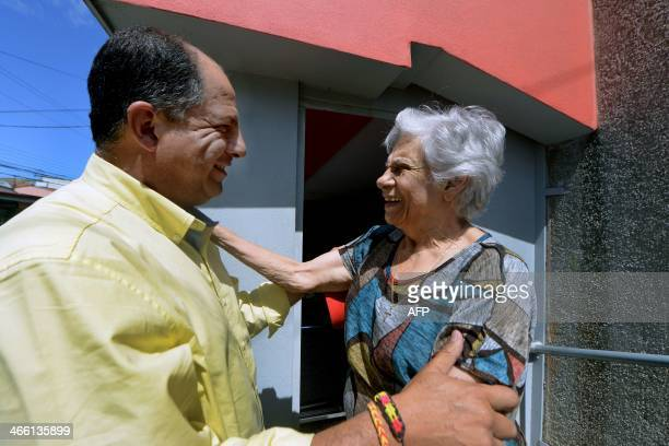 Costa Rican presidential candidate for the Accion Ciudadana party Luis Guillermo Solis greets a supporter during a walk in San Ramon 50km northeast...