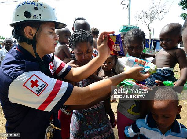 A Costa Rican Red Cross member distributes food to migrants in an encampment of Africans in Penas Blancas Guanacaste Costa Rica in the border with...