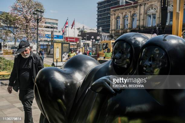 Costa Rican sculptor based in Italy Jorge Jimenez Deredia helps workers in the installation of 27 largescale art works outside the National Theater...