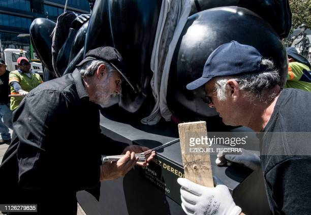 Costa Rican sculptor based in Italy Jorge Jimenez Deredia works in the installation of 27 largescale art works outside the National Theater in San...