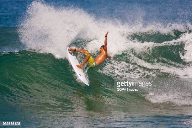 Costa Rican surfer on a wave in Langosta.