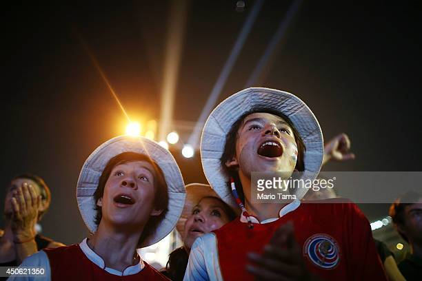 Costa Ricans celebrate while watching their victory over Uruguay at the FIFA Fan Fest on Copacaban Beach on June 14 2014 in Rio de Janeiro Brazil The...