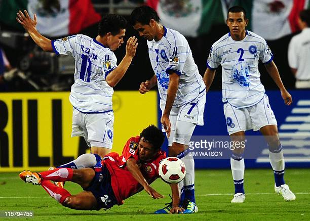 Costa Rica's Allen Guevara vies for the ball with El Salvador's Rodolfo Zelaya and Ramon Sanchez during Match 7 of the CONCACAF Gold Cup 2011 at Bank...