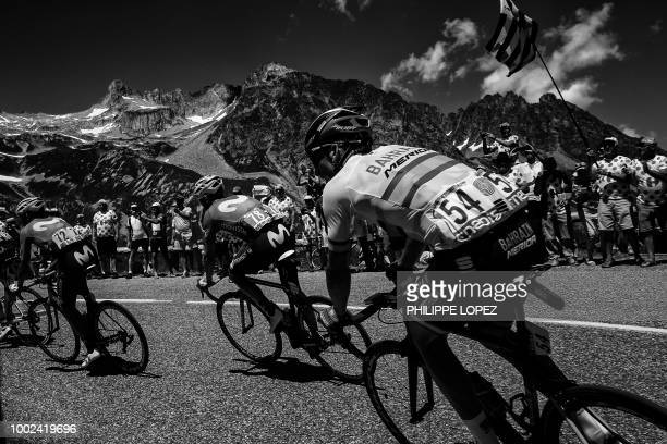 Costa Rica's Audrey Amador Spain's Alejandro Valverde and Spain's Gorka Izagirre ride up the Col de la Madeleine pass during the twelfth stage of the...