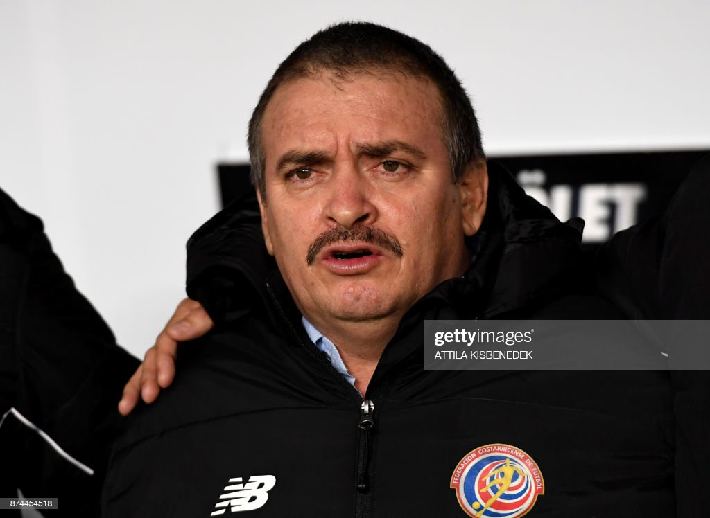 Costa Rica's coach Oscar Ramirez sings his national anthem prior to the international friendly football match Hungary v Costa Rica in Budapest, on November 14, 2017. /