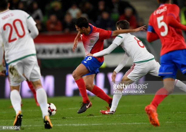 Costa Rica's Daniel Colindres vies with Hungary's Adam Nagy during the international friendly football match Hungary v Costa Rica in Budapest on...