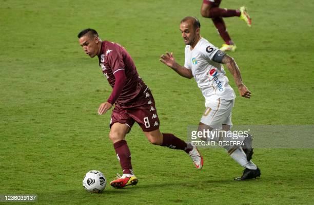 Costa Rica's David Guzman vies for the ball with uatemala's Comunicaciones Jose Contreras during their Concacaf Champions league quarter-final first...