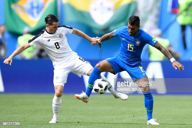 Costa Rica's defender Bryan Oviedo vies with Brazil's midfielder Paulinho during the Russia 2018 World Cup Group E football match between Brazil and...