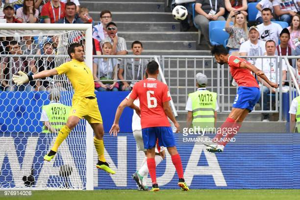 TOPSHOT Costa Rica's defender Giancarlo Gonzalez heads the ball as Serbia's goalkeeper Vladimir Stojkovic attempts to save it during the Russia 2018...