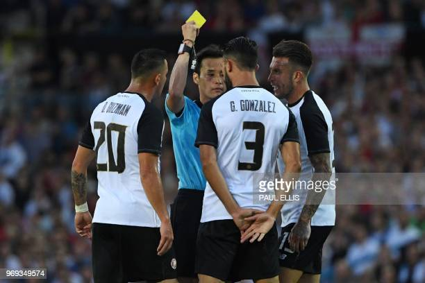 Costa Rica's defender Giancarlo Gonzalez is shown a yellow card by Japanese referee Hiroyuki Kimura during the International friendly football match...
