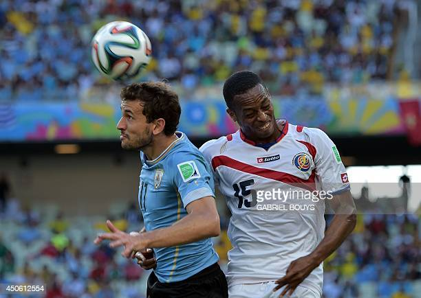 Costa Rica's defender Junior Diaz and Uruguay's forward Christian Stuani vie for the ball during a Group D football match between Uruguay and Costa...