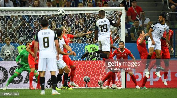 TOPSHOT Costa Rica's defender Kendall Waston heads the ball and scores his team's first goal during the Russia 2018 World Cup Group E football match...