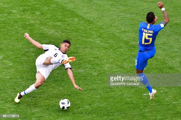 TOPSHOT Costa Rica's defender Oscar Duarte vies with Brazil's midfielder Paulinho during the Russia 2018 World Cup Group E football match between...