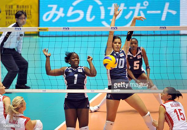 Costa Rica's Dionisia Thompson and Paola Ramirez Vargas block the ball against Poland during the first round of the world woman's volleyball...