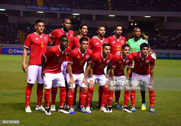 Costa Rica's football team pose for pictures before a friendly game against Venezuela at the National Stadium in San Jose on May 27 2016 / AFP /...