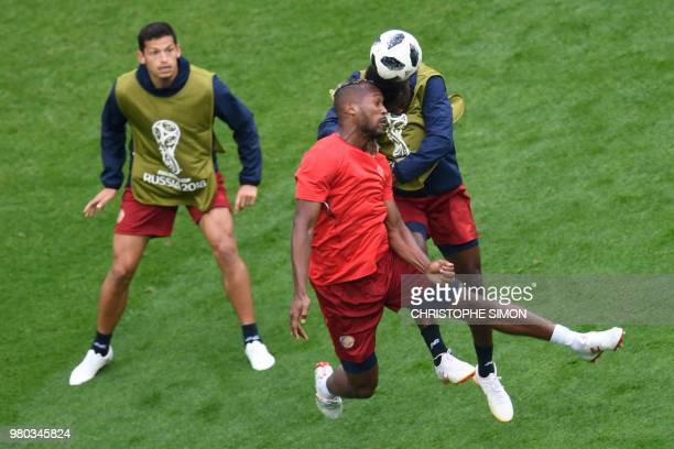 Costa Rica's forward Joel Campbell and Costa Rica's defender Kendall Waston jump for the ball during a training session at the Saint Petersburg...