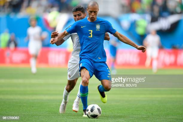 Costa Rica's forward Johan Venegas vies with Brazil's defender Miranda during the Russia 2018 World Cup Group E football match between Brazil and...