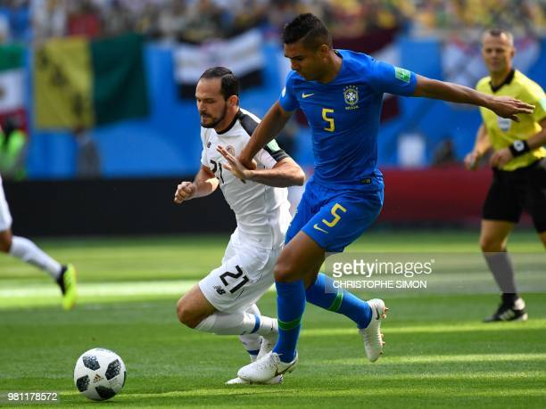 Costa Rica's forward Marco Urena is marked by Brazil's midfielder Casemiro during the Russia 2018 World Cup Group E football match between Brazil and...