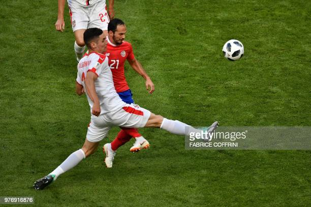 Costa Rica's forward Marco Urena is marked by Serbia's defender Nikola Milenkovic during the Russia 2018 World Cup Group E football match between...