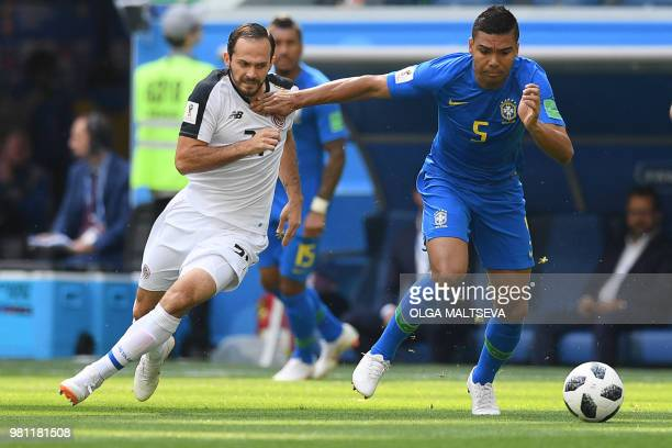 Costa Rica's forward Marco Urena marks Brazil's midfielder Casemiro during the Russia 2018 World Cup Group E football match between Brazil and Costa...