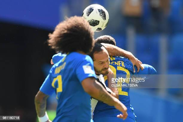 Costa Rica's forward Marco Urena vies for the header with Brazil's defender Fagner during the Russia 2018 World Cup Group E football match between...