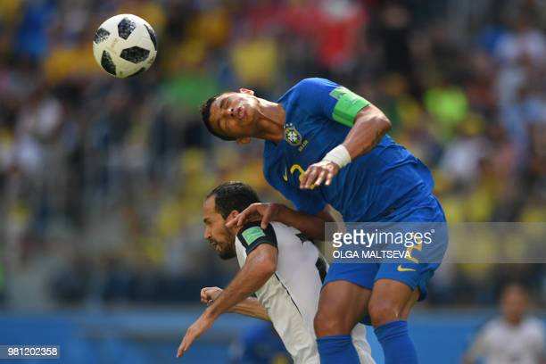 Costa Rica's forward Marco Urena vies for the header with Brazil's defender Thiago Silva during the Russia 2018 World Cup Group E football match...