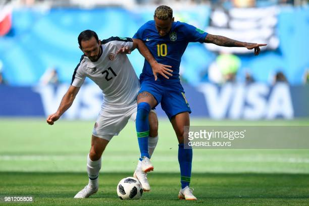 Costa Rica's forward Marco Urena vies with Brazil's forward Neymar during the Russia 2018 World Cup Group E football match between Brazil and Costa...