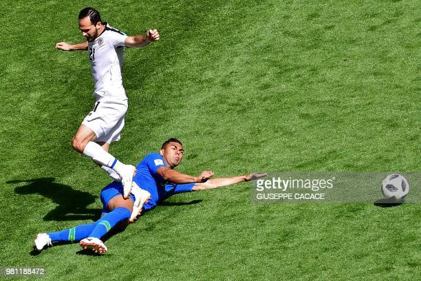 Costa Rica's forward Marco Urena vies with Brazil's midfielder Casemiro during the Russia 2018 World Cup Group E football match between Brazil and...